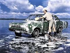 Nerd washing car over lake